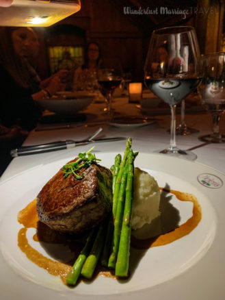 Steak with asparagus and a glass of red wine at Helen's