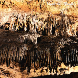 stalactites in hues of orange and browns in the caves