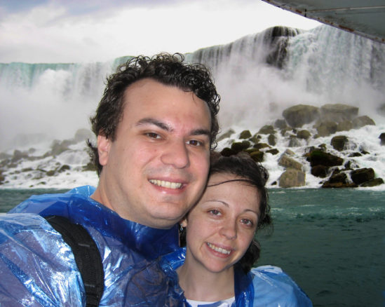 Alex and Bell in ponchos on the maid of the mist boat with the falls behind them when they visited Niagara falls