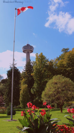 Canadian flag in the park with the Skylon tower in the background