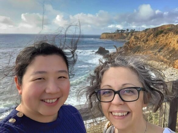 Bell and Fiona selfie in the cliffs with ocean in the background