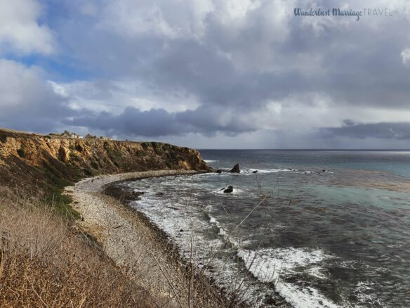 Rugged cliffs and Pacific Ocean with moody clouds for a hike on the weekend in LA