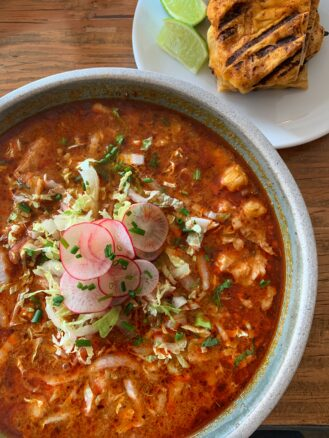 Bowl of chimayo posole top with radishes