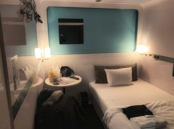 Cabin room, here there is a bed with a bedside table and enough room to walk around