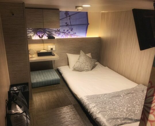 Cabin hotel room, bed and TV