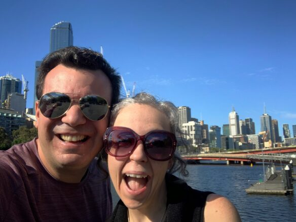 Alex and Bell along the Yara river with Melbourne skyline in the back