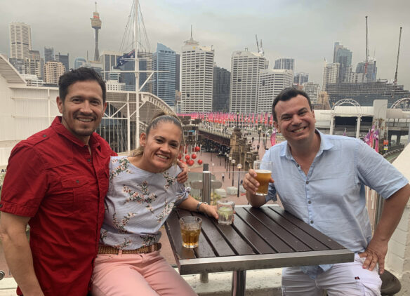 Alex and friends enjoying a beer with the sydney skyline