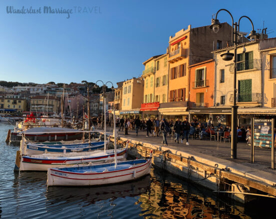 Harbor with boats and restaurants bathed in golden sunlight