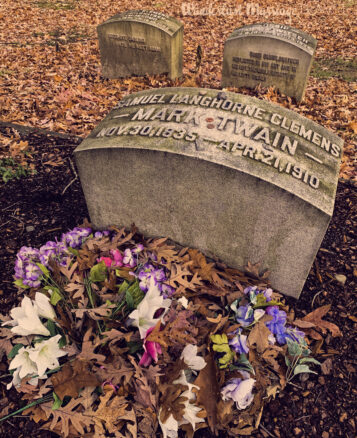 Mark Twain's grave surrounded by autumn leafs