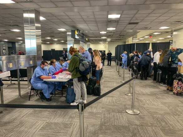 passengers receiving a health screening on arrival at Washington, DC Dulles Airport