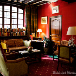cozy lounge with books and couches at Hotel de la Bretonnerie in the Marais district of Paris