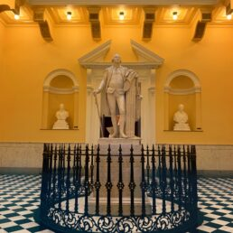 Statue of George Washington. Surrounded by black and white tiles in the Virgina State House