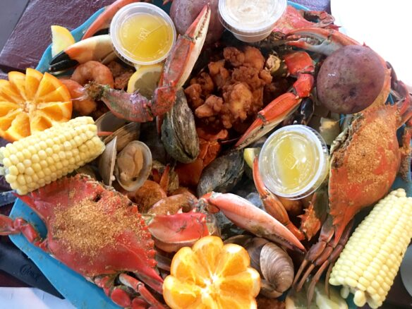 Plate of crabs, clams, shrimp and corn