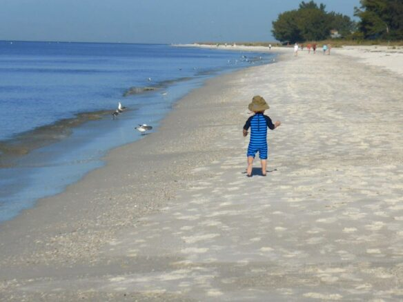 kid walking on the beach on Anna Maria Island, Florida