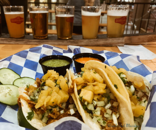 Plate of tacos and a flight of different beers at Silver Branch Brewing in Silver Spring, Maryland