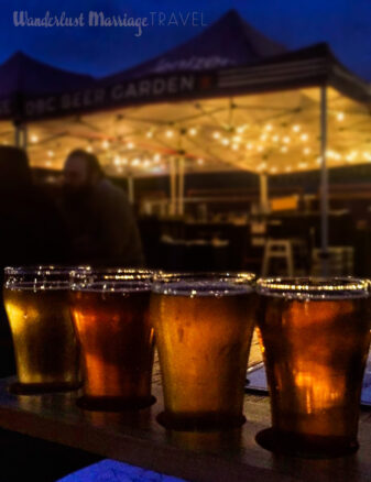 Photo of a flight of beers in the beer garden in the evening