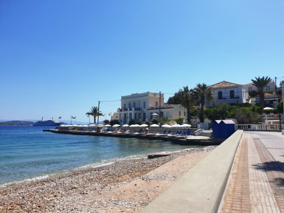 view of the sea and Spetses Town along the boardwalk on the Greek island of Spetses