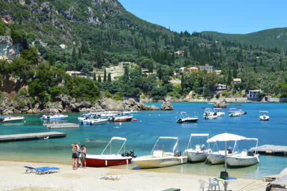 boats on the Ionian Sea along the beach in Corfu, Greece