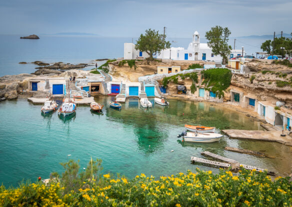 overlooking a marina with small boats on the Aegean Sea, in the Cyclades islands