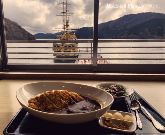 Katsu curry with a view of Lake Ashi, boat and mountains