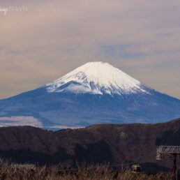 Photo of snow capped Mount Fuji with a cable car
