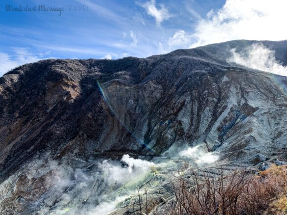 Photo of volcanic valley with Sulphur steam rising up