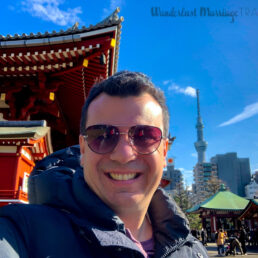 selfie of Alex at the Asakusa Temple, with Tokyo Tower in the background