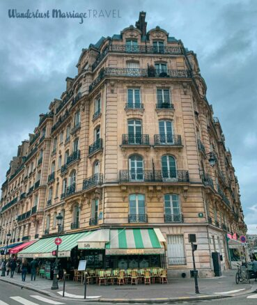 Typical Paris architecture and outdoor cafe seating