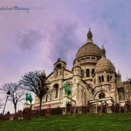 White church, a top a green hill and dusk sky in Paris