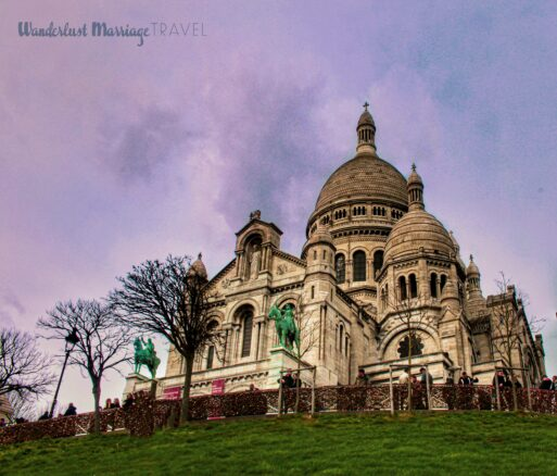 White church, a top a green hill and dusk sky in Paris