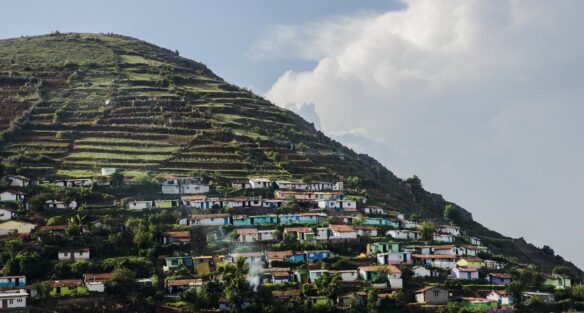 colorful houses built into the side of the mountain